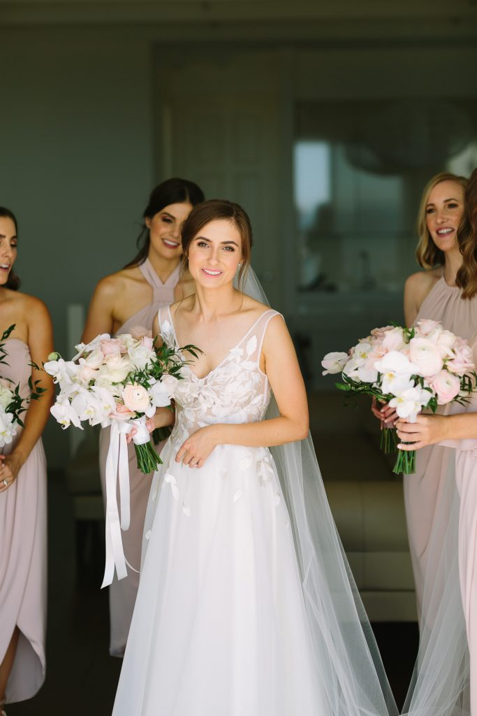 Bride and bridesmaids with beautiful florals