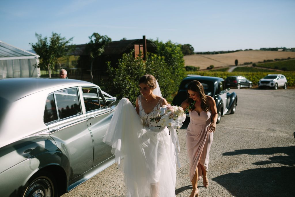 Bride arriving at Coriole winery wedding in Rolls Royce
