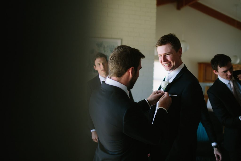 Groom and groomsmen getting ready at beach shack in Aldinga Adelaide