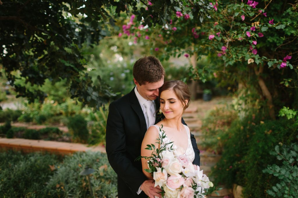 bride and groom with flowers in garden at coriole winery