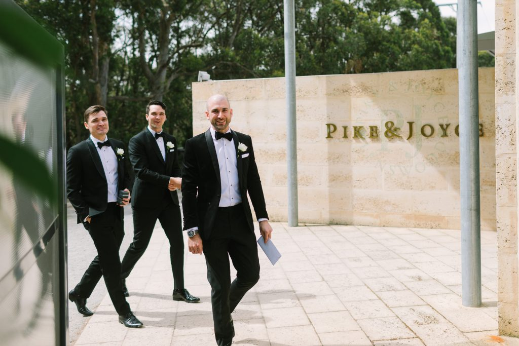 Groom and groomsmen arrive at Pike and Joyce winery for wedding ceremony