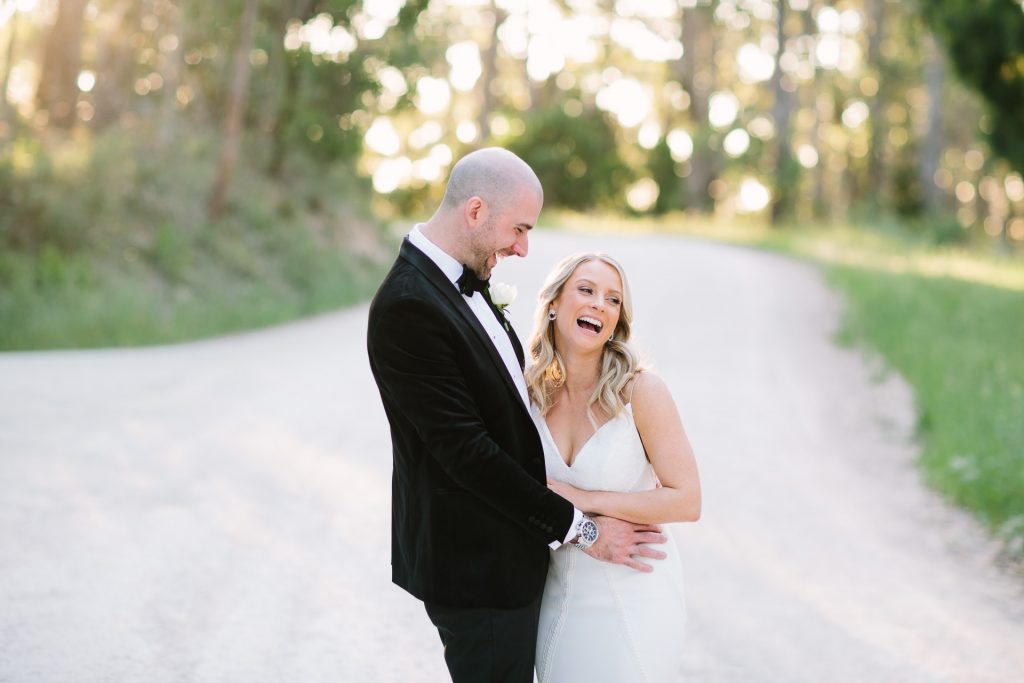 Bridal and groom laughing together at pike and joyce winery