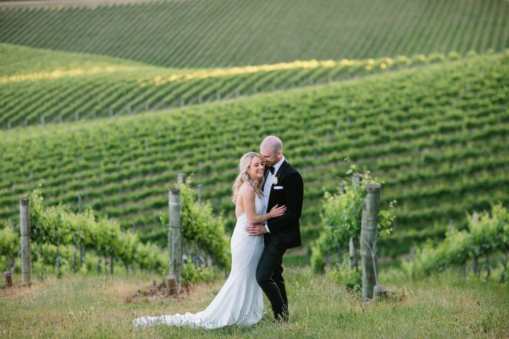 bride and groom location photos at pike and joyce winery in adelaide hills with beautiful view over vineyards
