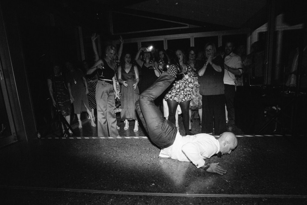 Groom doing the worm at his wedding on the dancefloor