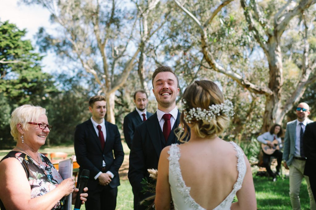 Groom overwhelmed by emotion when he sees his bride for the first time walking down the aisle at garden ceremony at Barn 1890 near Willunga, Mclarenvale