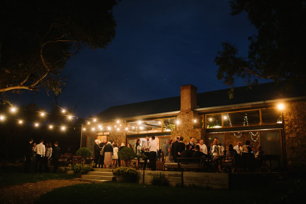 Speeches outdoor at dusk during the Reception at Barn 1890 wedding in WIllunga