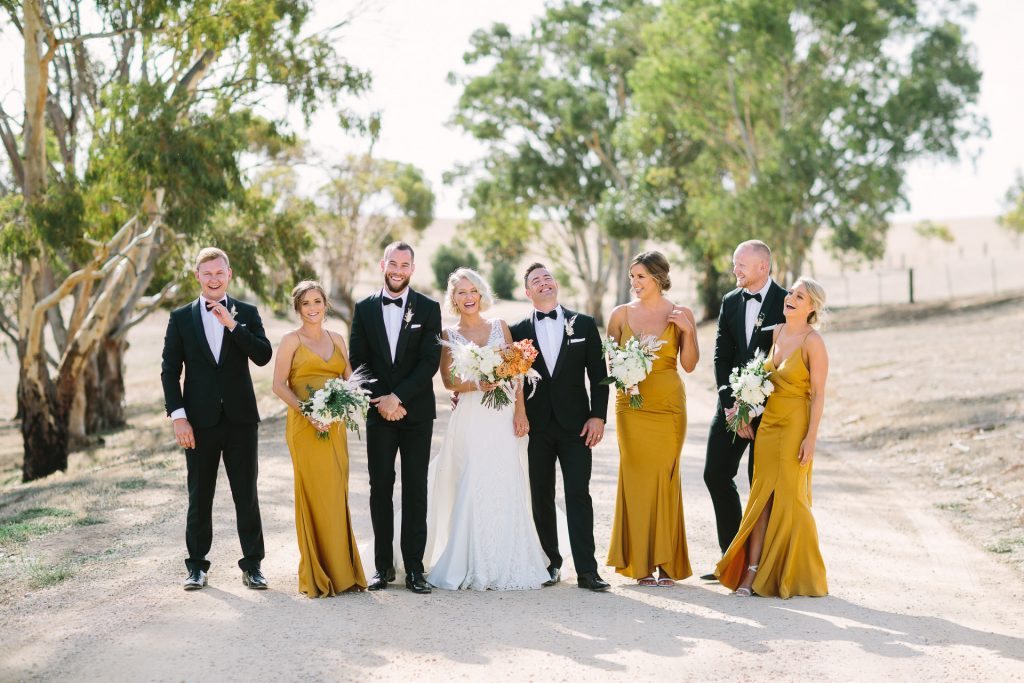 Bridal party laugh together at Kingsford Homestead wedding in the Barossa Valley