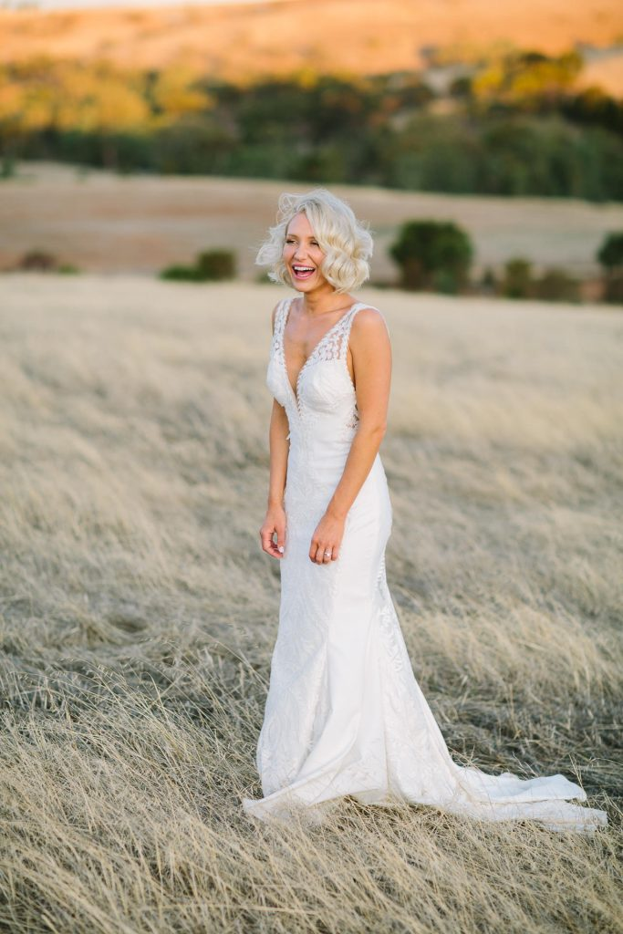 Happy bride in wedding gown at Kingsford Homestead