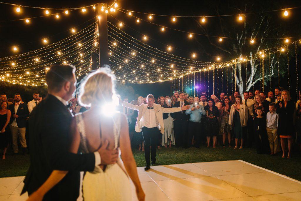 Father Daughter dance at Kingsford homestead wedding under festoon lights open air dance floor